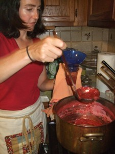 Allison ladling strawberry jam at Ten Apple class, july 2010