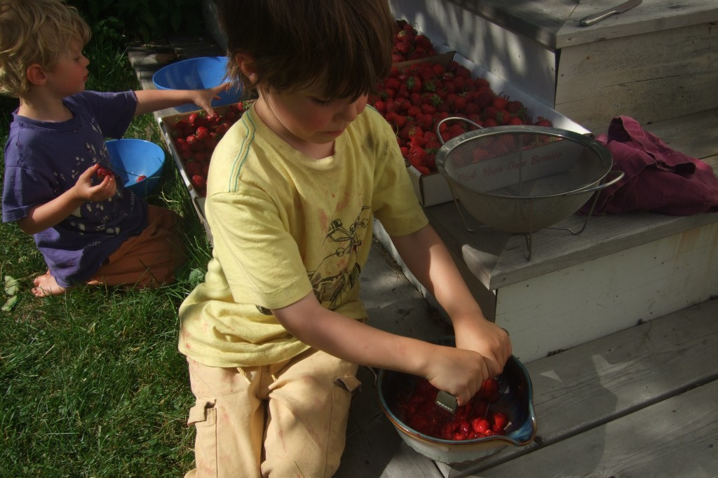 connor mashing berries for jam