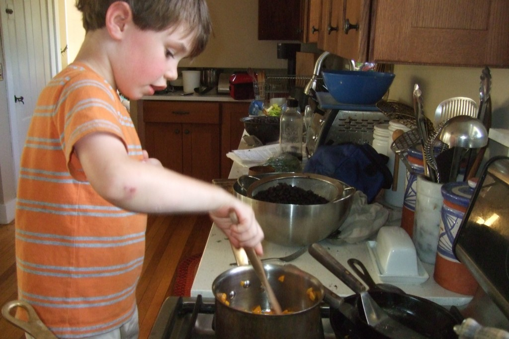 Connor cooking carrots