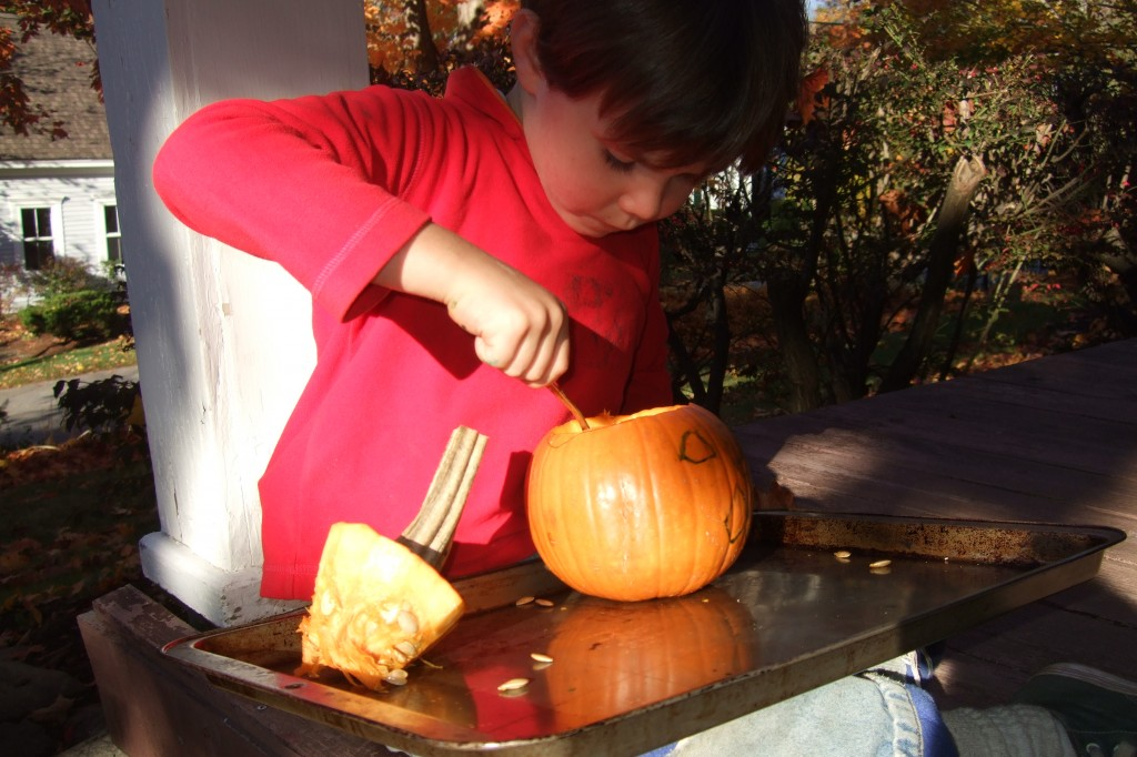 connor carving pumpkin
