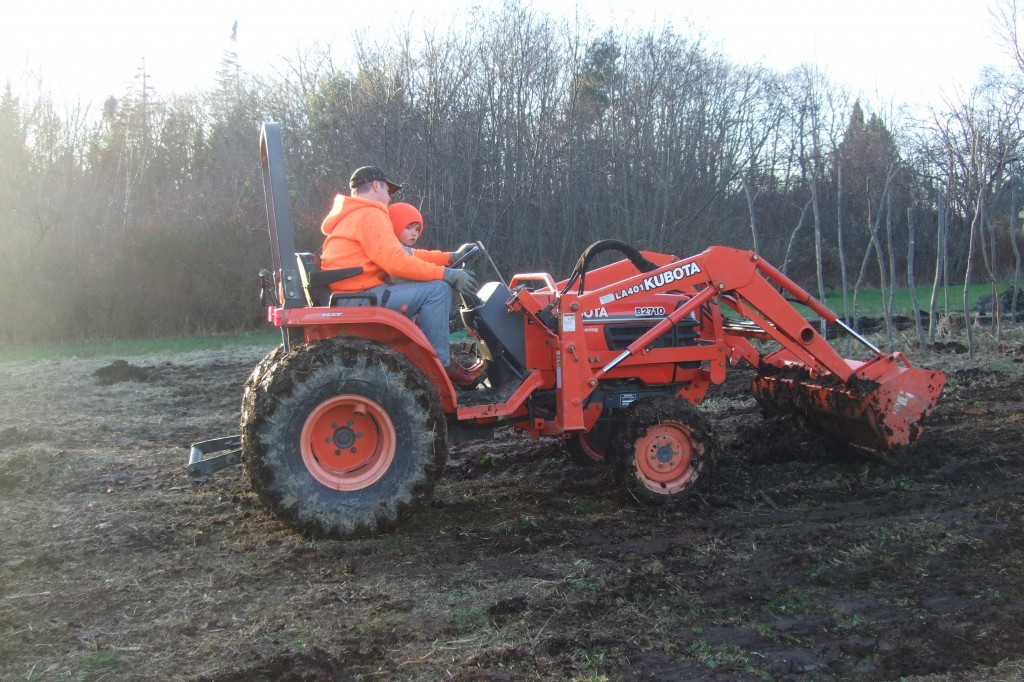 Ben and connor on tractor spreading manure