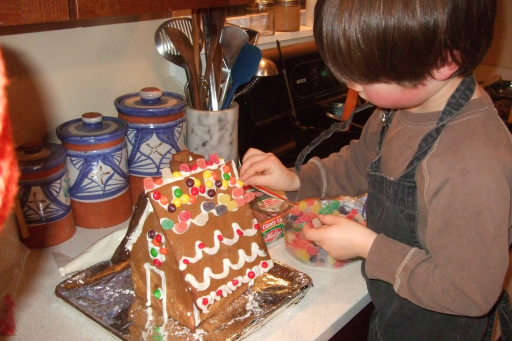 connor decorating gingerbread house