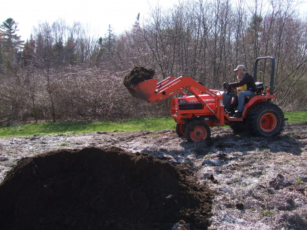 ben and ian dumping manure
